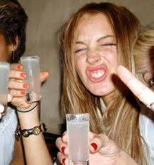 Snorting cocaine means you can drink MORE and Party till dawn!  Lindsay Lohan partying hard, drinking shots with a not so glamorous party face.