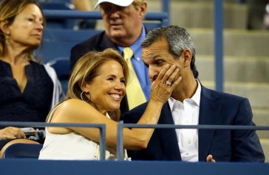 Katie Couric and fiance John Molner in a playful moment at the US Open