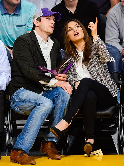 Mila Kunis Proudly Wearing Her Engagement Ring Watching the Pelicans Game with Ashton Kutcher