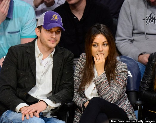 Mila Kunis studying the game while we study her Ring. No Longer Hiding her Engagement Ring